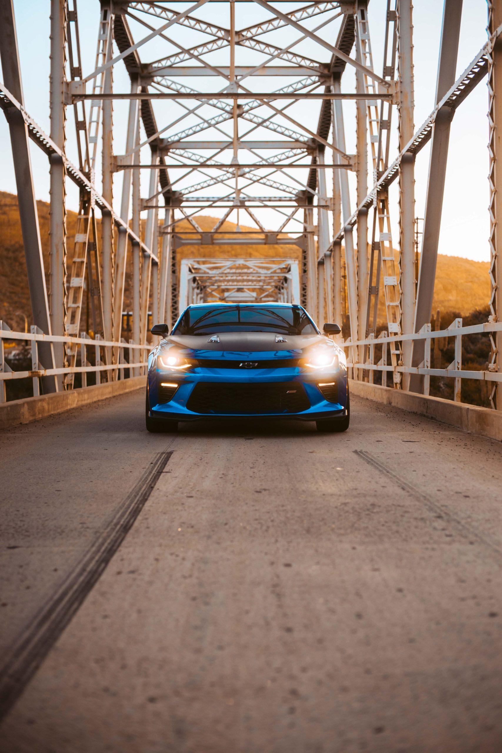 Blue Luxury Car on Bridge Background